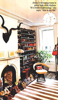The undeniably fab closet of J Crew creative director, Jenna Lyons.    Why, yes. I would put shoes in my fireplace, as well.