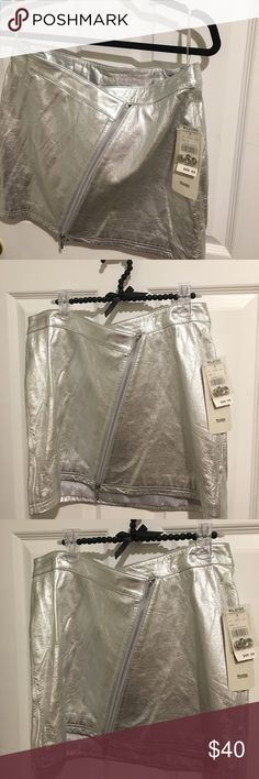 NWT Wilson's Silver Metallic Leather Mini Skirt 12 NWT Wilson's Leather Silver Metallic Mini -Skirt . Zips up the front . Comes completely open , then feed the zipper from the top of the skirt -downwards 👌There are indentations from clip hangars on the top leather trim in front and back , with it being more pronounced in the front as shown in photos . Total of 4 small clip- marks . Should be fine to wear with a belt or with a top that covers it if it bothers you ✅ Super cute skirt Wilsons…