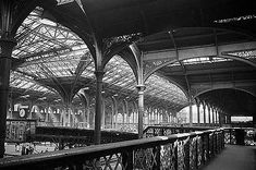 The interior of Liverpool Street Station showing the footbridge over the Continental Boat Train arrival platform and the ornate cast iron roof structure John Gay1960 English Heritage NMR