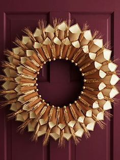 Thankful wreath - write what you're thankful for on Thanksgiving and tuck it into the cones on the wreath