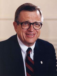 Chuck Colson with buttondown collar and striped tie