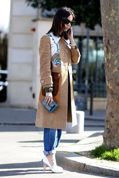The best lesson in street style is to pair your statement pieces, like this box-clutch and overcoat, with your more casual, go-to wardrobe staples.