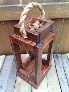 Decorative Rustic Reclaimed Wood Candle Holder Lantern. Looks Great with Rustic or Country decor. American Walnut is pictured. Lantern also available in Kona, Ebony, White, Driftwood(which is great for a beachy look) or weathered gray!  The Lantern measures at 14in X 7.75in X 7in. Great gift for Mothers Day