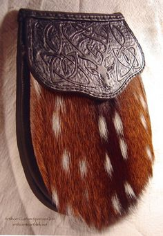 Quarter-view showing relief on the Celtic Knot & Red Deer flap.  Axis Deer hide.