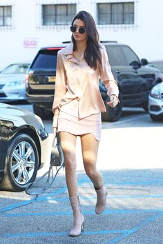 Kendall Jenner looks every bit pretty in pink in this all-over blush ensemble—but she's adding a bit of spice to the sweet look, too. The model, who admittedly loves to go braless, gives a subtle flash of her infamous nipple ring in this silky sheer blouse, making our cheeks turn a similar flushed hue.    - MarieClaire.com