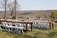 Farm table with white folding chairs