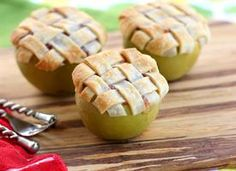 Apple Lattice Pie Baked in an Apple. Recipe cops out and says to use canned apple pie filling, but I bet you could cook something up with the apple you spoon out--add some cinnamon and brown sugar and cook in a little bourbon on the stove for 10 minutes.