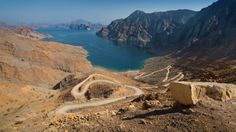 Dubai to Oman, Middle East: From Dubai, drive past magnificent folding sand dunes, stunning mountain ranges and the odd oasis fringed with date palms to the Musandam Peninsula in Oman,...