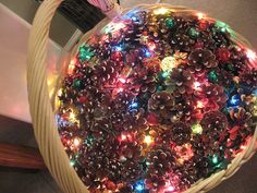 Pine Cone Basket by ECWC, via Flickr.  Super easy to do! Place Christmas lights (colored or white) in bottom of med. to large size basket. Fill basket up with pine cones! Decorate with ribbons on basket if you wish! Simple!