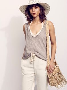 Bombay Tank | In an easy, oversized fit this heathered tank features a scoop neck and raw, unfished trim. Semi-sheer style.