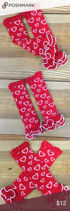"""Red & White Heart Leg Warmers Our girls red leg warmers with white hearts and ruffles are so cute with a dress or skirt set! They fit newborns to girls to young adults. Approx. 12 """" in length. They make diaper changes a breeze for babies and toddlers. They really """"pop"""" in photos! Shop our boutique for a matching outfit! Moxie Girl Accessories Socks & Tights"""