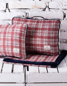 Gramercy Travel Set. It contains a warm blanket and pillow, which come in a coordinating zippered bag.