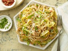 Zucchini Ribbon Pasta from FoodNetwork.com Holy yum!  Made this for dinner tonight with squash from the garden.  <3<3<3