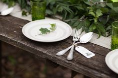 Rustic table setting in white and green colors. Objects: - vintage wooden table with linen tablecloth; - white plate with green leaves; Wooden Tables, Rustic Table, Vintage Table, Forks And Spoons, White Plates, White Candles, Linen Tablecloth, Rustic Lighting, Home Look