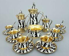 Russisches Mokkaservice, 925 Silber, vergoldet, schwarz-weiß emailliert,16 Teile