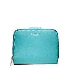 COACH Saffiano Leather Medium Zip Around Wallet.  I got this as a gift for my birthday. It's small, yet it fit everything in my long wallet and more! It's also such a beautiful color.