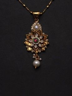 Pendant set with white and pink stone and pearl