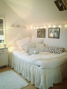 clean and airy white dorm room design with lights