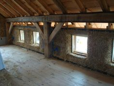 Straw bale construction buildipedia straw bale 101 strawbale building faq many hands how to create a load bearing straw bale Exposed Interior Timber Frame In Cob Building, Building A House, Green Building, Straw Bale Construction, Earth Bag Homes, Tadelakt, Straw Bales, Natural Building, Post And Beam