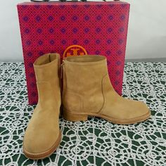 Nwt authentic tory Burch tan Tuscan booties Has gold tory Burch emblems on both sides, can be dressed up or down these are extremely beautiful  boots, sipper  in the back , tan suede with wooden short heel, says split suede, these come with box nwt, tag is on the box, 100%  authentic Tory Burch Shoes Ankle Boots & Booties