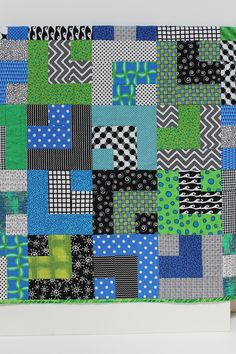 """This """"William"""" is made with beautiful blues and greens, and the backing is a bright kelly green."""