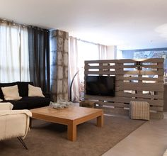 Studio apartment that's big on style room divider screen using reclaimed timber pallets