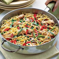 One easy way to kick up the flavor in a dish is to add Cajun seasoning. Here, the seasoning is sprinkled on the chicken strips before they're sautéed and tossed into the linguine-vegetable mixture.