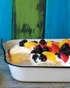 Tres Leches Cake - Martha Stewart Recipes.  This is the best and easiest tres leches cake I've ever made.  Instead of fruit on top add chocolate curls, a caramel drizzle, colorful birthday sprinkles, or decorate with a pastry bag and frosting.  It's delicious!