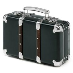 Manufactum. Affordable trolley case style luggage made of cardboard and wood.