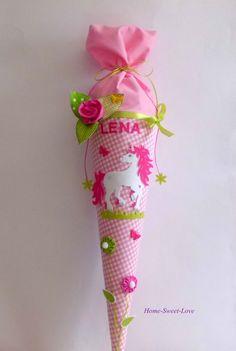 **Schultüte Zauber-Einhorn** ♥ Tütenkorpus ca.70cm + ca.30cm Stoffverschluss ♥ Stoff & Papprohling sind verklebt/ **KEIN KISSEN** ♥ 6 Buchstaben sind im Preis enthalten, jeder weitere Buchstabe...