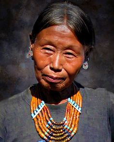 People portrait photograpy.  Travel Photography. https://flic.kr/p/Do8rEQ | Konyak woman | North East India. The Seven Sister States. Nagaland. Mon district, Konyak tribe.  Shangnyu Village Ruled by the chief Angh, Shangnyu village is one of the prominent villages in Mon district.