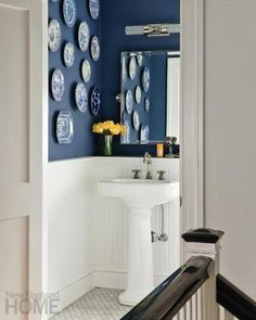 Drawing Room Blue from Farrow & Ball brings rich color to this powder room.  Interior design:  Kristine Mullaney, Photography: Michael J. Lee Double Vision: Hollywood Glam Comes to Brookline | New England Home Magazine