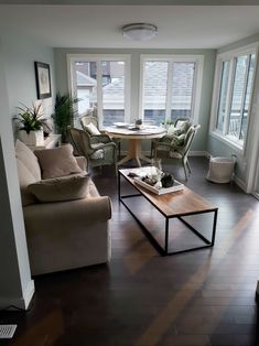 This four season sunroom features vinyl plank flooring, and has a patio door on to the deck. Four Season Sunroom, Floor Insulation, Green Hydrangea, Living Spaces, Living Room, Vinyl Plank Flooring, Patio Doors, Sunrooms, Seasons