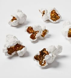 Porcelain popcorn, with gold glaze - sculptures by LA based artist Pae White.