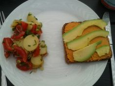 Vegan - Salad made of tomatoes, potatoes, spring onions and chives. Bread with tomatospread and avocado.
