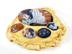 Painted stone cats by Ernestina Gallina