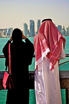 A Qatari couple watching the Doha skyline from the Museum of Islamic Art Hijab Bride, Girl Hijab, Wedding Hijab, Wedding Dresses, Muslim Couple Photography, Photography Poses, Wedding Photography, Cute Muslim Couples, Cute Couples