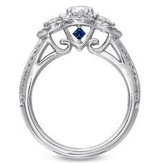 i love sapphires and have looked into incorporating them into my engagement ring. i love this! way to go Vera Wang on this design.