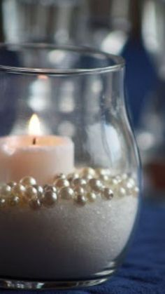 Photo courtesy of Kim Candles and pearls make the perfect centerpiece for a wedding or wedding shower especially if you are planning a winter wonderland theme wedding. Small candles, faux pearls in a Pearl Centerpiece, Candle Centerpieces, Centerpiece Ideas, Simple Centerpieces, Pearl Wedding Centerpieces, Candle Decorations, Graduation Centerpiece, Inexpensive Wedding Centerpieces, Pearl Decorations