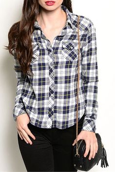 Casually stylish, get the look with this flattering form fitted navy blue plaid top by JW Signature. -Arrow Trends