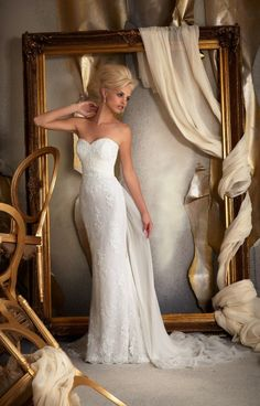 Mori Lee Bridal 1914Lace and chiffon meet to create a simple and stunning silhouette in Mori Lee 1914. This strapless fully lace gown features a sweetheart neckline and elegant sheath dress cut to skim all of your curves without hugging too tight. Your small waist will be accented by the ruched chiffon waistband. Add a dramatic feel by attaching the optional chiffon skirt.