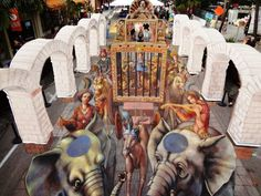 Kurt Wenner 3D chalk pavement art, 13 people from around the world were chosen to work with him. The 3D illusion is created on 2D surfaces.