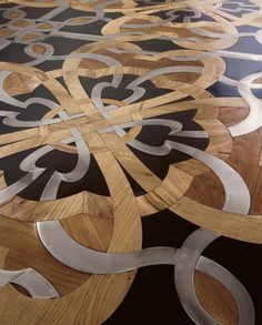 Mosaic floor of wood, stone and steel by Parchettificio