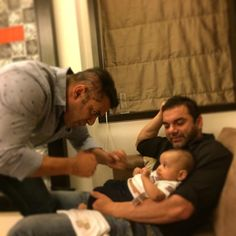 Awww! Salman Khan playing with his nephew baby boy Ahil as brother Sohail looking on. via Voompla.com