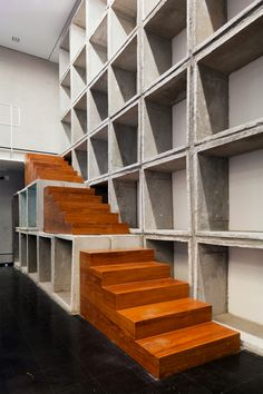 When the Brazilian graphic design company Casa Rex moved into this 1940s residential building in downtown Sao Paulo, the stripped the interiors back, before adding in simple additions, such as this concrete and wooden staircase, which leads to an elevated walkway.