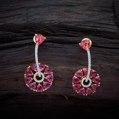 Sparkling CZ Zircon Hanging earrings studded with Ruby synthetic stones, with gold Polish.