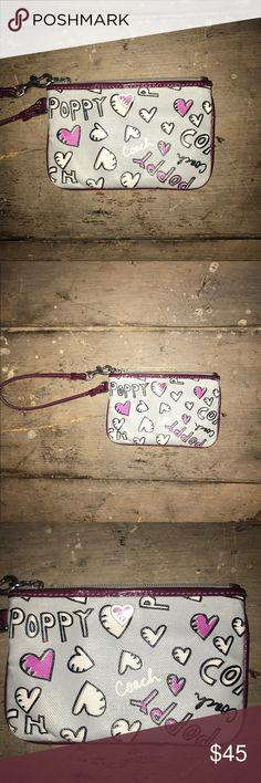 Coach Poppy Gray Wristlet Gray Coach Poppy wristlet with fuchsia wristband. Slight scuffs on back (see photo) Coach Bags Wallets