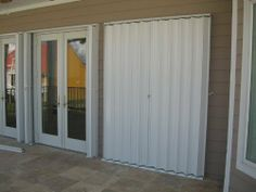 Accordion Hurricane Shutters, Bertha HV accordion shutters ours come with a 10 Year Warranty Unique Garage Doors, Black Garage Doors, Wooden Garage Doors, Garage Door Styles, Garage Door Design, Barn Doors, Accordion Hurricane Shutters, Accordion Shutters, Old Shutters