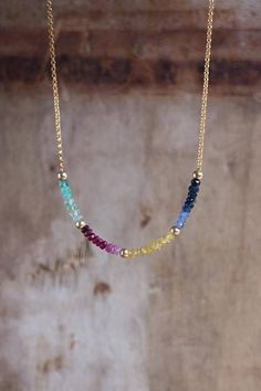 Dazzling natural precious gemstones have been carefully hand-picked and strung to create this beautiful Rainbow Necklace! Emerald, Ruby, Padparadscha, Yellow and Blue Sapphire each featuring an ombre design have been stationed between gold beads and finished with 14K Gold Fill chain,
