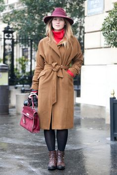 Winter-Style Reboot: 224 Street Snaps to Inspire You Now: Shades of red and cozy textures — plus a pair of walkable, buckled booties — mean this casual look was cooler than most.  Source: Adam Katz Sinding : Raspberry hues united and gave this classic coat a rich contrast. Source: Adam Katz Sinding